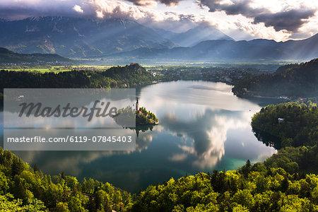 Lake Bled reflections at sunrise, Julian Alps, Gorenjska, Slovenia, Europe