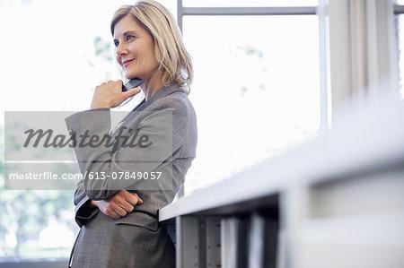 Proud businesswoman in office