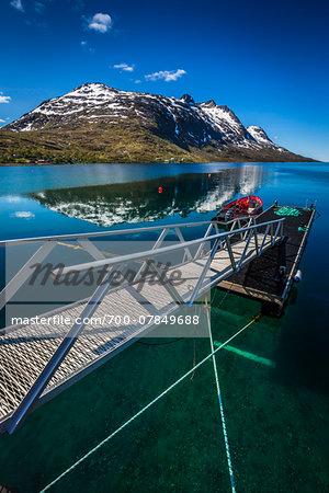 Dock and mountain, Ersfjordbotn on the Island of Kvaloya, near Tromsoe, Troms, Northern Norway, Norway