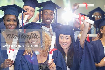Portrait of university students standing in corridor after graduation ceremony