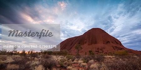 Uluru Kata Tjuta national park, Northern Territory, Australia. Uluru at sunset, under a stormy sky