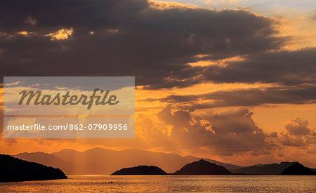 Indonesia, Lesser Sunda Islands, Rinca. Sunset over Komodo Island.