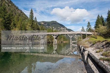 Landscape with Bridge over Lake Plansee in Autumn, Tirol, Austria