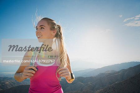 Woman hiking, Joshua Tree National Park, California, US
