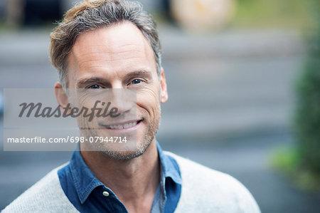 Portrait of smiling man on street