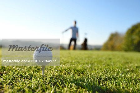 Golf Ball on Tee on Golf Course in Autumn, Bavaria, Germany