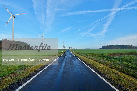 Country Road in Morning with Wind Turbines, Freiensteinau, Vogelsbergkreis, Hesse, Germany