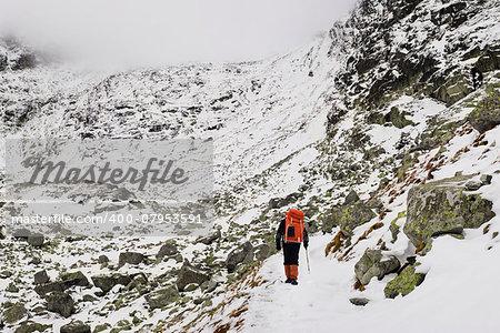 Alpinist climbing on mountain route up to peak in High Tatras. Slovakia. Poland. High Tatras