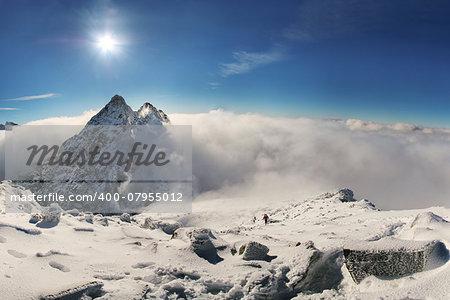 Alpinist climbing on Rysy mountain peak in High Tatras. Slovakia. Poland. High Tatras