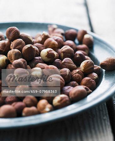 Hazelnuts on a metal plate