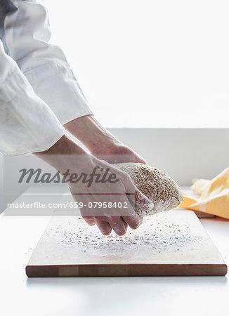 A backer kneading bread dough