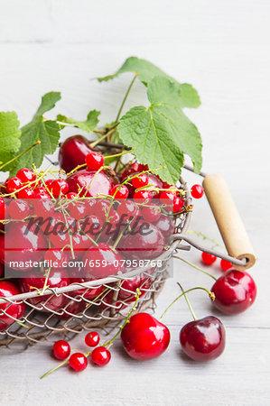 An arrangement of red summer fruits