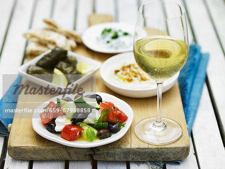 Greek food, white wine and unleavened bread