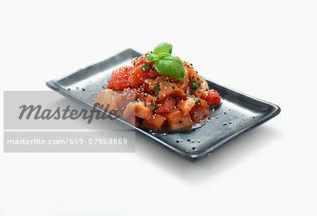 Sashimi with sesame seeds and basil