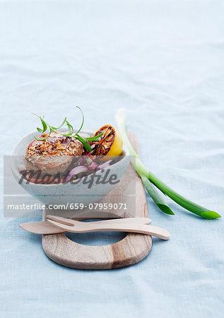 Pork steak with an orange marinade on a bean salad