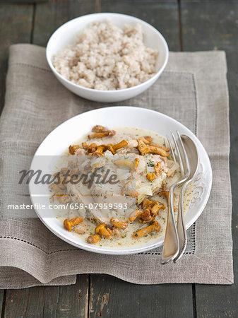 Pork loin in a creamy mushroom sauce with chanterelle mushrooms