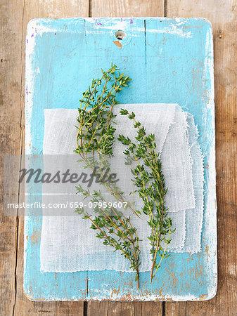 Fresh thyme on a blue wooden board