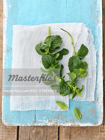 Fresh mint on a blue wooden board