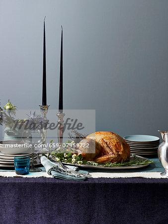 Roast turkey on a festive table