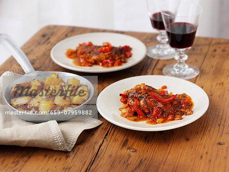 Piri-piri chicken with roast potatoes and wine