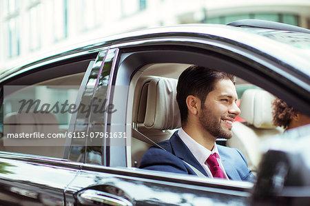 Businessman smiling in car