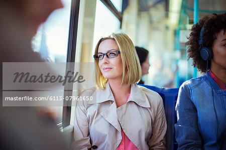 Businesswoman sitting on train