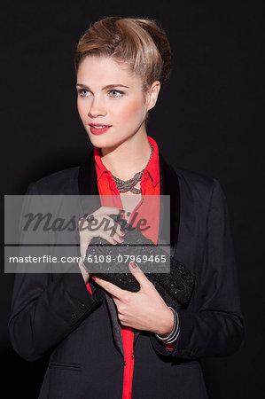 Beautiful woman holding a purse