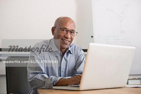 Portrait African man office laptop computer