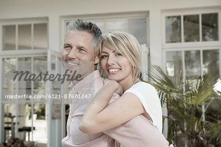 Couple married hugging garden portrait smiling
