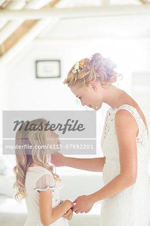 Bride talking to bridesmaid in domestic room