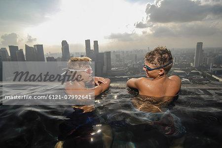 Teenage boys in an infinity pool, Marina Bay Sands, Singapore City, Singapore