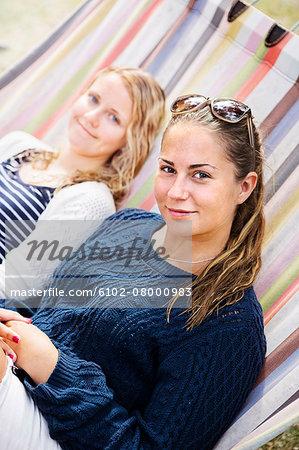 Teenage girls on hammock