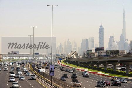 Looking along Sheikh Zayed road towards the business district and Burj Khalifa; Dubai, United Arab Emirates