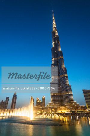 Fountain display in front of the Burj Khalifa at sunset; Dubai, United Arab Emirates