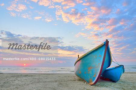 Boat on beautiful beach in sunrise on Black Sea
