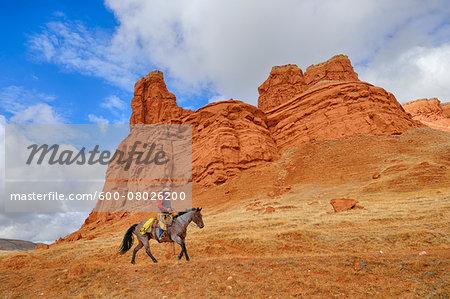 Cowboy Riding Horse, Wyoming, USA