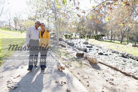 Husband and wife taking walk, Hahn Park, Los Angeles, California, USA