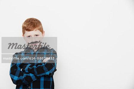 Boy wearing fake moustache