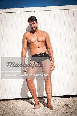 Muscular man at beach, Miami Beach, Florida, USA