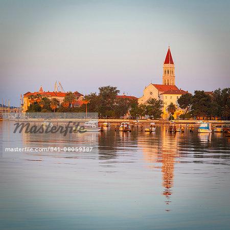 Cathedral of St. Lawrence illuminated at sunrise, Stari Grad (Old Town), Trogir, Dalmatia, Croatia, Europe