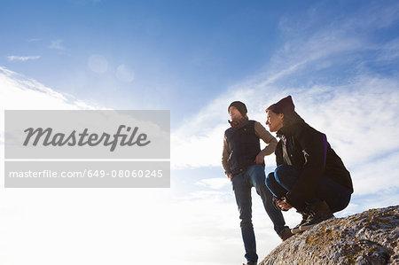 Couple on top of rock, Connemara, Ireland