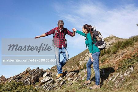 Hikers trekking on hilltop, Montseny, Barcelona, Catalonia, Spain