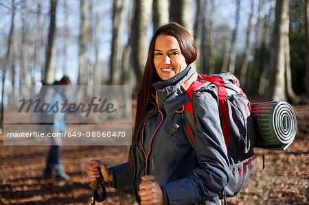 Hikers walking across woods, Montseny, Barcelona, Catalonia, Spain