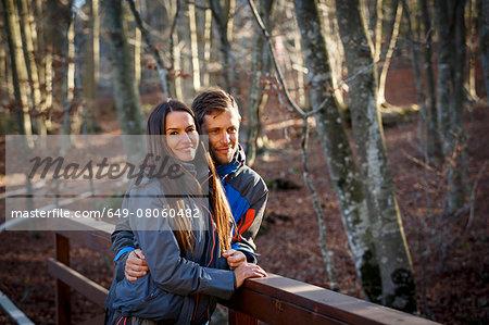 Hikers on bridge by stream, Montseny, Barcelona, Catalonia, Spain