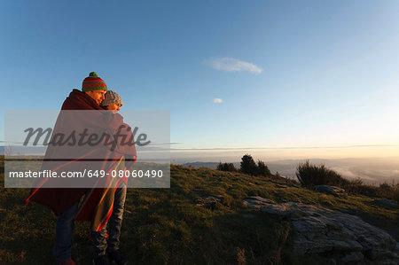 Couple enjoying view from hilltop, Montseny, Barcelona, Catalonia, Spain