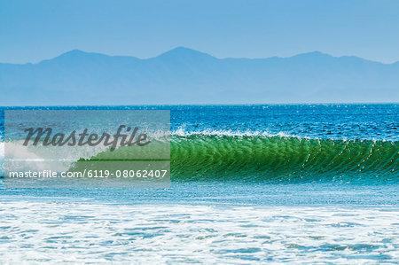 Classic curling shore break surf wave, typical of this coast, Playa Hermosa, San Juan del Sur, Rivas Province, Nicaragua, Central America