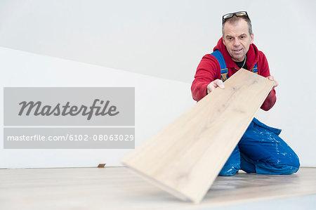 Man lying laminate floor