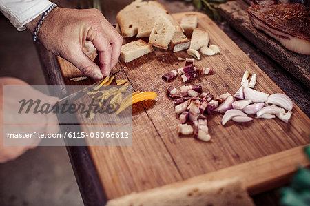 Person preparing dish, cutting ingredients