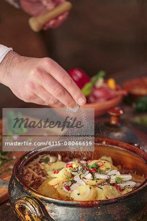 Unrecognizable person seasoning food