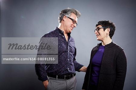 Studio portrait of mature couple face to face